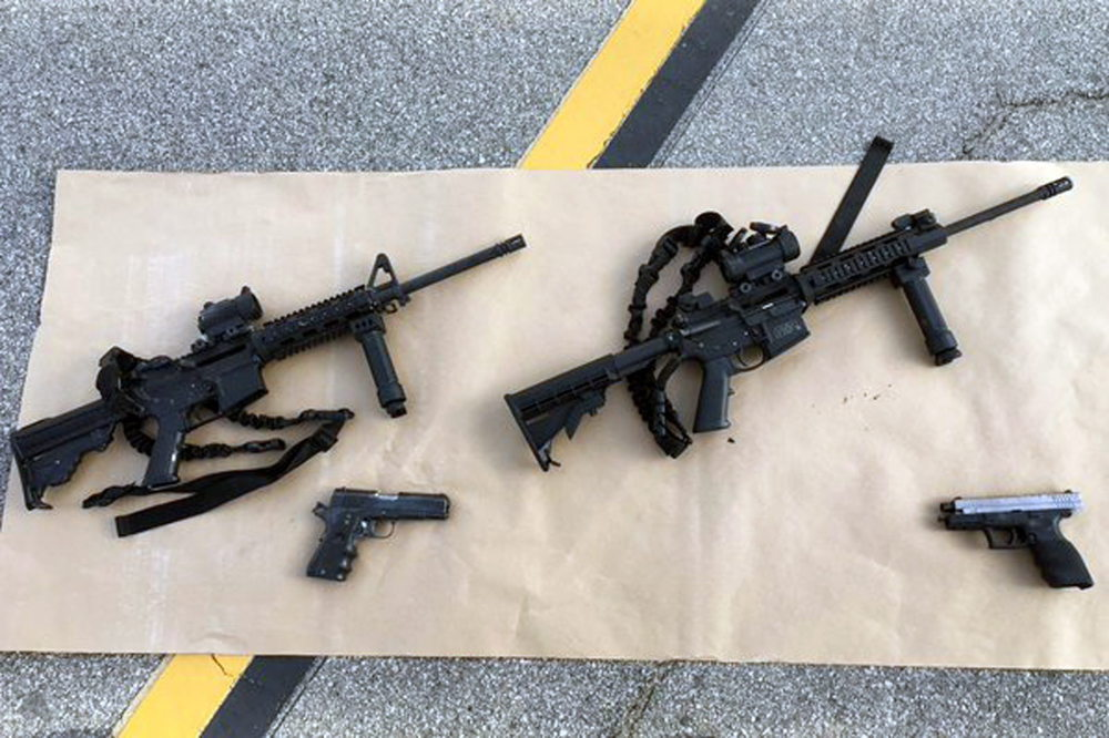 epa05053818 An undated handout picture made available by the San Bernardino County Sheriff on 03 December 2015 shows weapons carried by suspects involved in a mass shooting, at the scene of a shooting with an officer, in San Bernardino, California, USA. Investigators were searching on 03 December for a motive in a California massacre that left 14 people dead and 21 others wounded as US President Barack Obama said the mass shooting could be tied to terrorism. Obama said it will take time to uncover the extent of the shooters' plans and their motivations. The suspects, who died in a shootout with police hours after the massacre on 02 December 2015 at a conference centre, were husband and wife, Syed Rizwan Farook, 28, and Tashfeen Malik, 27, the San Bernardino County Sheriff's Office said. The shooting spree targeted a holiday party inside the building. EPA/SAN BERNARDINO COUNTY SHERIFF BEST QUALITY AVAILABLE HANDOUT EDITORIAL USE ONLY/NO SALES Dostawca: PAP/EPA.