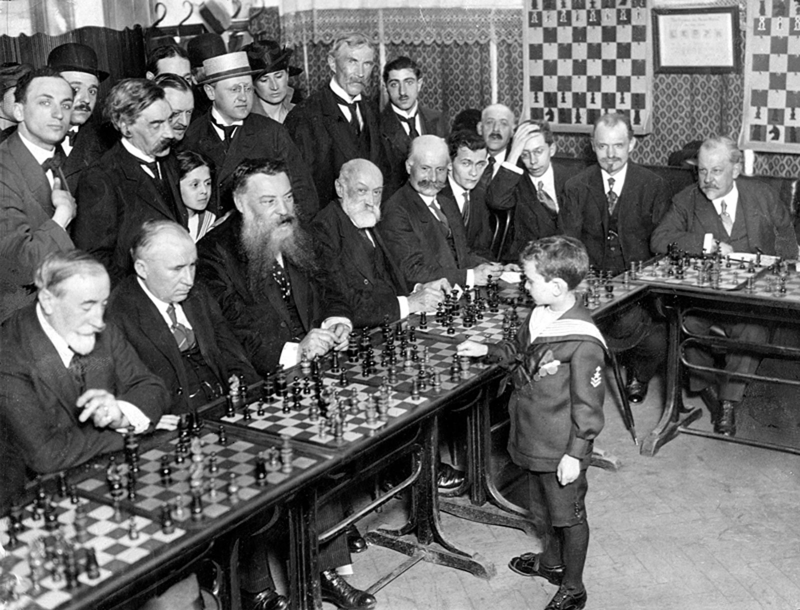 Samuel Reshevsky, age 8, defeating several chess masters at once in France, 1920 - Imgur