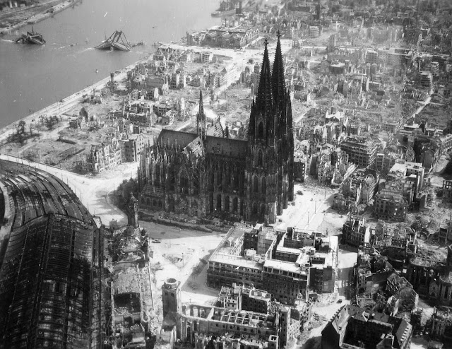 The Cologne cathedral stands tall amidst the ruins of the city after allied bombings, 1944 - Imgur