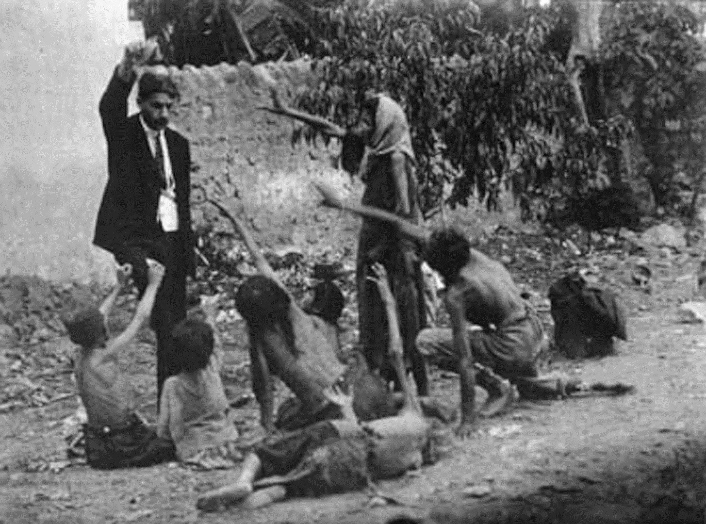 Turkish official teasing starved Armenian children by showing bread during the Armenian Genocide, 1915 - Imgur