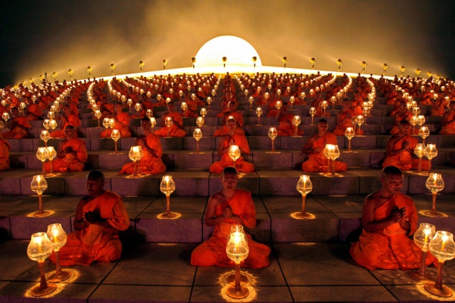 Buddhist monks' ritual before starting the paper lanterns. Suphan Buri Province, Thailand.