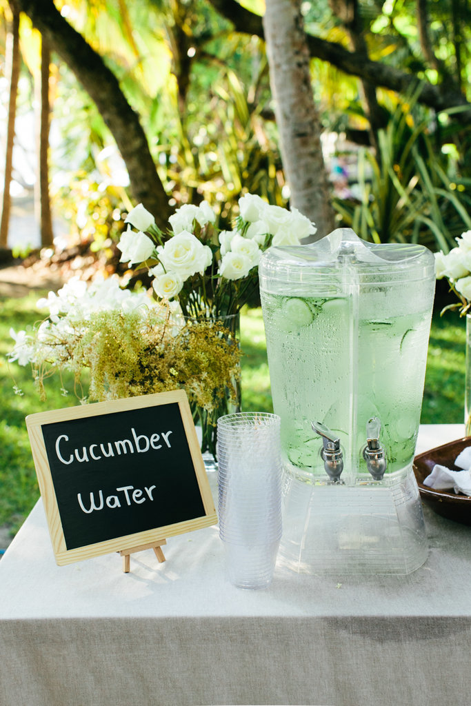 Green on green — cucumber water is a bright addition to a lush outdoor setting.
