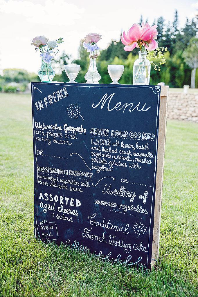Let your guests know what's on the menu by setting up a flower-adorned chalkboard menu outside.