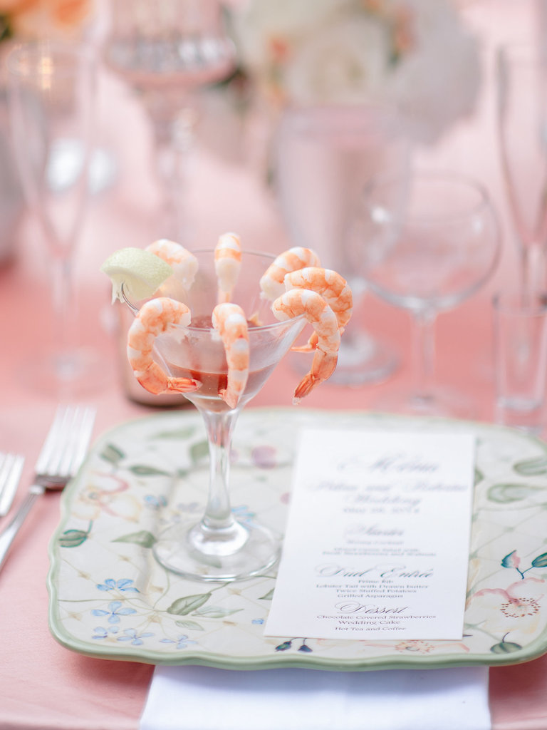 Shrimp cocktail pops against a pastel-pink tablescape.