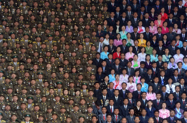The North Korean military and civilians at the stadium of Kim Il Sung.