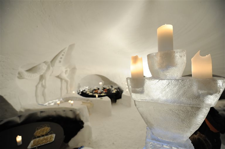 The igloo with snow tables and candles – Iglu-Dorf, Switzerland
