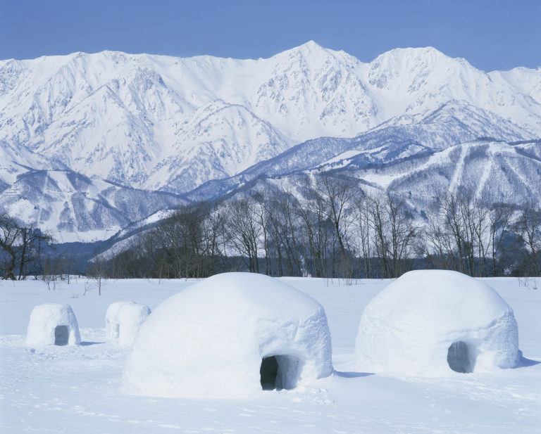 Japan, Nagano Prefecture, Igloos on snow covered landscape