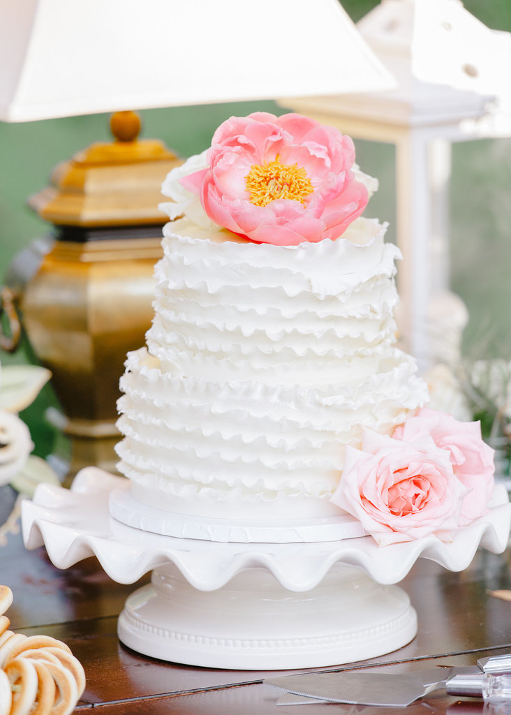 There's something so sweet about this simple but beautiful cake — the ruffles and flowers make a perfectly classic combo.