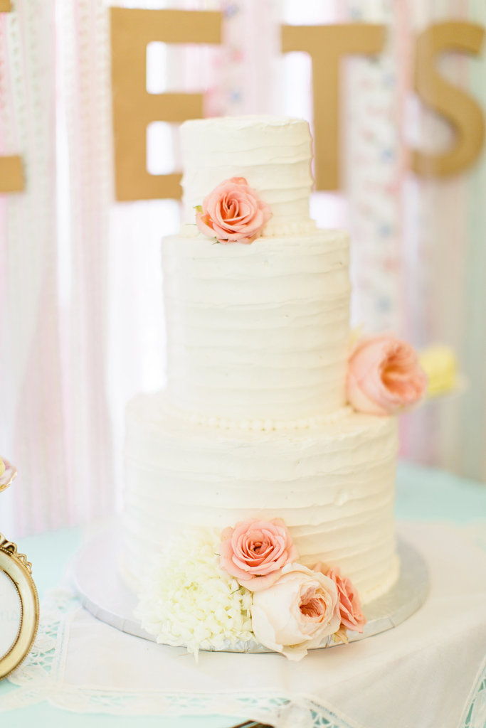 This romantic, vintage cake features minimalist detail and is absolutely stunning