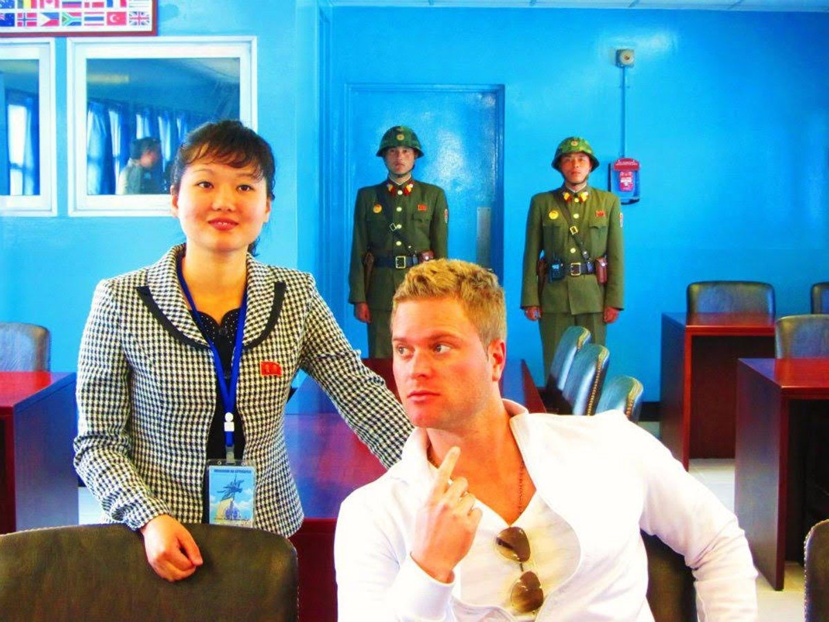 despite-this-they-were-able-to-talk-the-guards-into-allowing-them-inside-one-of-the-blue-huts-south-korea-begins-just-behind-the-last-two-guards-pictured-here-behind-justin