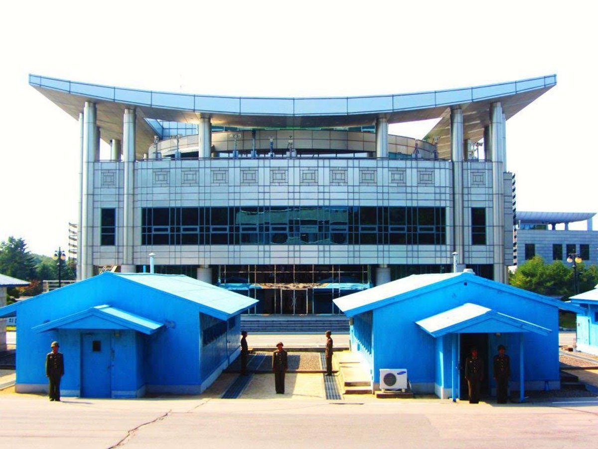 the-border-between-south-korea-and-north-korea-starts-at-the-concrete-line-between-the-blue-huts-pictured-here-former-us-president-bill-clinton-once-called-the-area-which-is-the-most-heavily-milita