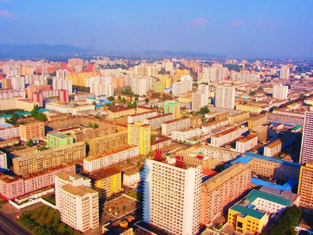 this-shot-of-the-capital-city-of-pyongyang-was-taken-in-flight-upon-landing-their-cameras-and-phones-were-searched-for-gps-capability-and-their-passports-were-seized-until-their-departure-the-scari