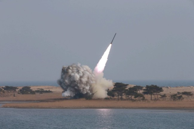 epa05193753 An undated photograph made available on 04 March 2016 by the North Korean news agency KCNA showing the test-firing of new-type large-caliber multiple launch rocket system. North Korea fired several short-range rockets off its the eastern coast 03 March 2016, South Korea said, just hours after the UN imposed its strictest sanctions ever on Pyongyang. The rockets were fired from Wonsan on the east coast, and all fell in the sea, a Defence Ministry spokesman said. While attending the rocket test Kim Jong Un, supreme commander of the Korean People's Army, said the military should also be ready to carry out pre-emptive attacks, North Korea's official KCNA news agency reported. North Korea's nuclear weapons should be ready for use at 'any moment,' leader Kim Jong Un said, according to state media, amid heightened tensions on the Korean peninsula.  EPA/KCNA  Dostawca: PAP/EPA.