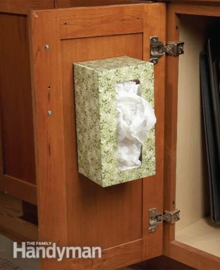 A recycled tissue box to store garbage bags.