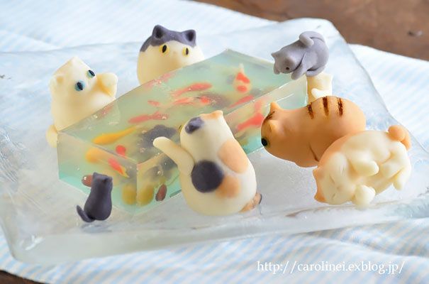 Candy Cats Trying To Catch Goldfish Stuck In Jelly