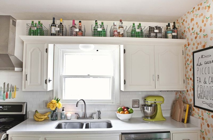 Wicker baskets on top of kitchen cabinets.