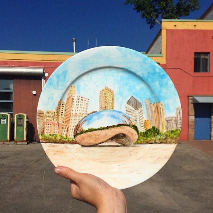 Artystka używając talerzy, odtwarza krajobrazy