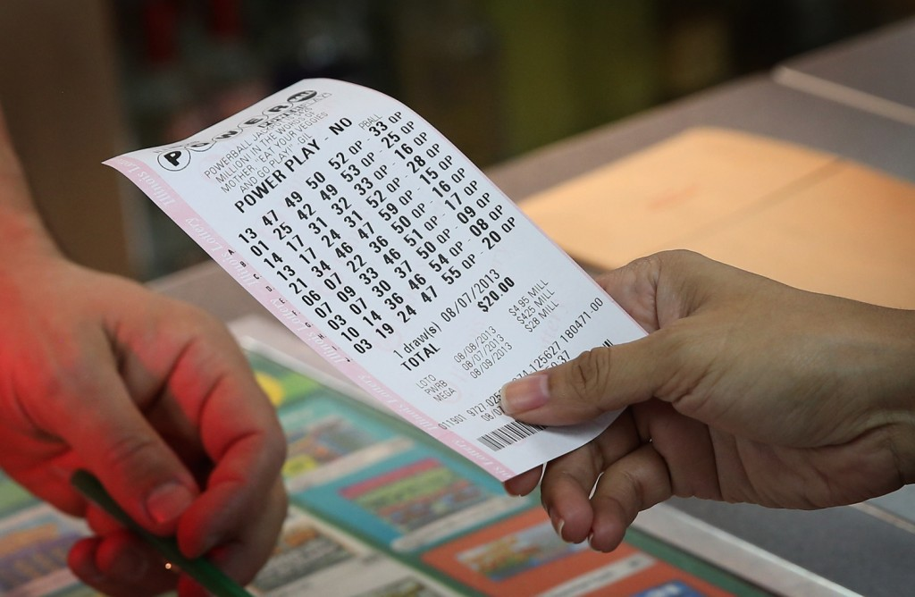 CHICAGO, IL - AUGUST 07: A customer purchases a Powerball lottery ticket at a 7-Eleven store on August 7, 2013 in Chicago, Illinois. The Powerball jackpot for tonight's drawing is $425 million, the third-highest total ever. (Photo by Scott Olson/Getty Images)
